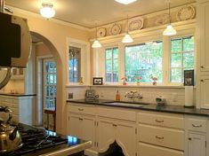 Off the kitchen, the home's formal dining room features wide plank floors, art glass windows, and a unique built-in folding window shelf (pi. Bungalow Homes, Kitchen Remodel, Kitchen Design, Bungalow Kitchen, Vintage Kitchen, New Kitchen, Craftsman Kitchen, Kitchen Styling, Bungalow Interiors