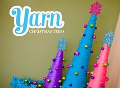 Yarn Christmas Trees - You don't have to use traditional colors for holiday crafts. This is a great example of fun and unexpected Christmas decor ideas. #tutorial