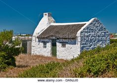 white washed reed thatched roof cottages in Hotagterklip have been designated as national Monuments, Struis Bay, - Stock Photo