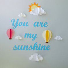 You are My Sunshine With Clouds and Hot Air Balloons by Gosh & Golly - This wall art stands out — literally — with its 3-D clouds and hot ai...