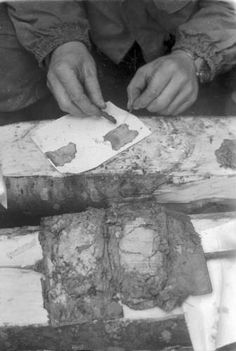 attempt to identify soldier's remains by piecing together papers preserved by the low oxygen swamp.