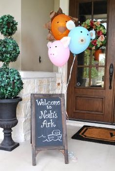 """Use chalkboard easel to write """"welcome to gabba land"""" with picture of Brobee. Painted pumpkins can sit beneath it."""