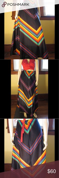 "VTG 70s Chevron Rainbow Stripes Aline Maxi Skirt Vintage 70s ultra groovy jet black chevron rainbow print maxi skirt in BOLD vibrant colors that POP. High waisted fit, elasticized waistband,belt loops at sides. Full & flairy A-line shaping w/sweeping hem. A must-have for the Grooviest Hippie-Gal.  SZ:16 (Fits M) Waist:24"" unstretched to app 32"" or 34"" slightly snug Hips:up to app 42"" Lgth:41"" Brand:N/A Material:Polyester,unlined Condition:EX/Only minor flaw to is a small tear (app 1"") at LT…"