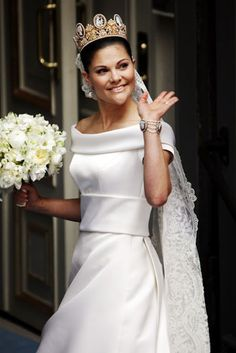 Crown Princess Victoria of Sweden married her personal trainer Daniel Westling in a classic off-the-shoulder satin gown by Pär Engsheden, which featured a sixteen-and-a-half-foot train
