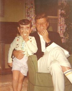 JFK and JFK — President Kennedy with daughter Caroline in a Kennedy Halloween mask, 1962.