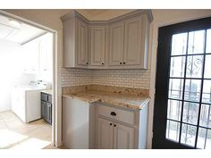 Gray cabinets, subway tile, drawer pulls