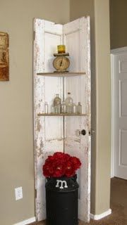 Old door transformed into a corner shelf.  And I already have all the treasures pictured