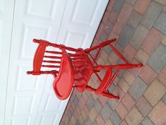Restored vintage high chair. Wood painted red.