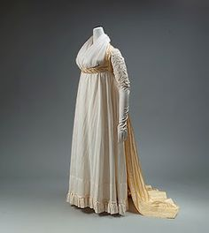 An extant open robe from the the late 1790s, early 1800s.  The open robe is an over dress, with short, 3/4 or long sleeves, the drapes the full length of the gown, but is open in front, closing with a belt under the bust.     The pelisse and spencer are for outside, travelling, and riding, whereas the open robe is more of an evening or indoor garment