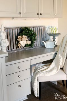 China Cabinet Makeover/Love this cabinet makeover, but what I'm really looking at is the delightful grey basket/tray behind the wreath and the cute planter(is that really a pie pan married to a candlestick and painted grey?) on the right side. How cute.