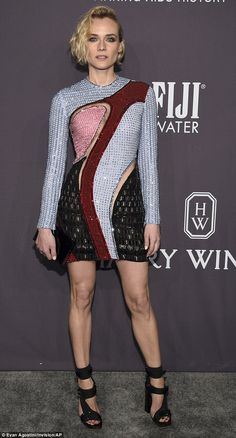 Brought her A game: Diane Kruger, 40,  rocked a multi-colored long-sleeved mini dress as she arrived at the amfAR gala at Cipriani Wall Street in New York on Wednesday night