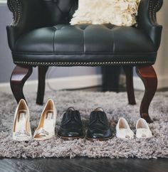 Wedding Shoes. Photography. Wedding details. Clickkity. Black wing back chair. Wood floors. Gorgeous wedding. Ruffle pillows.