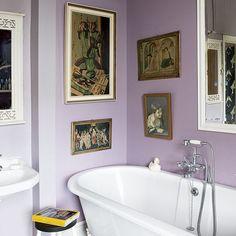 Mauve bathroom  Soothing mauve walls, a roll-top ClawF00T and classic paintings evoke a nostalgic feel.