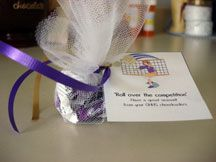 """Package TOOTSIE ROLLS in a small bag and attach this note - """"Roll over the Competition!"""""""