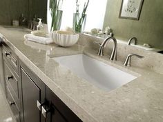 Engineered marble countertop is an alternative to natural stone. Made from 93 percent marble and seven percent resin and pigments, it requires less maintenance and offers greater durability. Photo courtesy of Cosentino Marlique Marble Caring For Granite Countertops, Marble Countertops Bathroom, Outdoor Kitchen Countertops, Painting Countertops, Bathroom Countertops, Bathroom Cabinets, Quartz Countertops, Sink Countertop, Marble Bathrooms