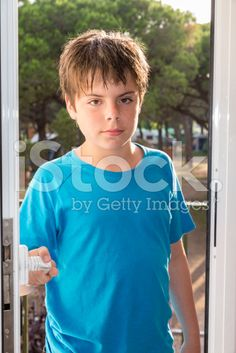 child opening a door royalty-free stock photo