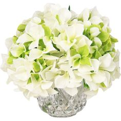 Add a charming centerpiece to your desk or coffee table with this beautiful faux hydrangea arrangement, showcasing lush blooms nestled in a cut glass vase.
