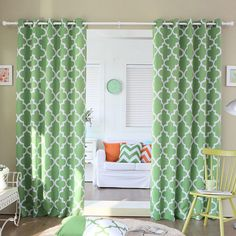 Featuring a triple-weave construction for maximum insulation, these Moroccan-style room darkening curtains are both stylish and functional. Available in five bright colors, this curtain set comes with decorative antique bronze grommets.