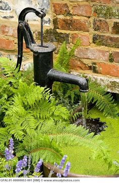 Water feature; pump antique; [we have this in our garden and aim to replace the barrel with a water feature running down the garden; we can then sit on the swing lounger and look up at the water trickling towards us; and I can sit and dangle my feet into the pool! That's our garden project for 2012]