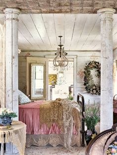 Whimsical Victorian  Elaborately transform worn-in interiors with vintage fabrics, trims of old lace and other aged materials. Rather than working against the space, these touches, displayed here in the master bedroom's rose-colored linens and camel and white overlays, create a lush experience. Victorian chandeliers, vintage china, farmhouse chairs offer a setting that's rich with history.