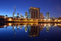 A photograph of Montreal skyline with its reflection in Lachine Channel in the foreground