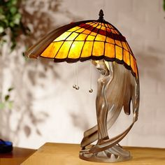 "Valais -  Tiffany table lamp with ""awning"" shade and a bronze base. Magnificent !"