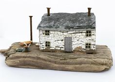 Old stone cottage. Love the flaky paint on this bit of driftwood!