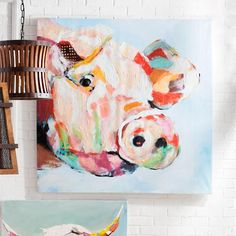Bessie has a cousin! And the farm a new addition: Penelope the Pig. This brilliant and charming composition captures our Penelope peering up with an inquisitive smile and a friendly eye. Just like Bessie, Penelope is handpainted with significant texture for the look of an original work of art. She's got real character and spunk. Hang next to Bessie or showcase Penelope all by herself. She's a doll. Colorful pig wall art Printed gicl on cotton canvas...
