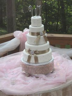 Wedding cake complete with rhinestone trim and beautiful broaches that match bridesmaids broaches on dresses.