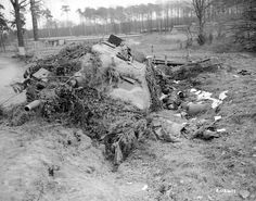 "Disbabled German tank destroyer ""Hetzer» (Jagdpanzer 38). A crew member lies dead in the ditch."