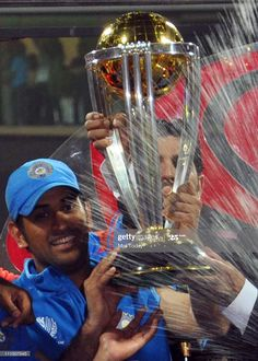 Indian Cricket Team Mahendra Singh Dhoni poses with the trophy after victory in the Cricket World Cup 2011 final over Sri Lanka at The Wankhede Stadium in Mumbai on April India beat Sri. Get premium, high resolution news photos at Getty Images 2011 Cricket World Cup, India Cricket Team, Ms Doni, History Of Cricket, Dhoni Quotes, Ms Dhoni Wallpapers, World Cup Trophy, Ms Dhoni Photos, Cricket Wallpapers