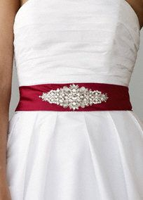 """Add color and sparkle to your gown with this beaded satin sash.  Features beautifully beaded center embellishment.  Total length approximately 130"""".  Embellishment dimensions are 6"""" length by 2"""" wide.  Imported.  Available in our exclusive20 color palette."""