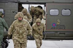 Royal Air Force Reservists from 606 (Chiltern) Squadron based at RAF Benson disembarking a Puma helicopter during a training weekend at the . Royal Air Force, Canada Goose Jackets, Winter Jackets, Military, Training, History, Winter Coats, Historia, Winter Vest Outfits