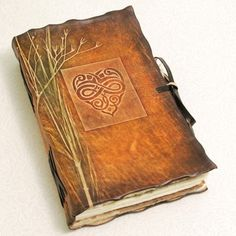 Leather book with celtic design on the front.   Relevant Scheeeeeme: Christmas Present for Megan
