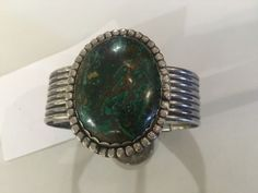Unusual Navajo Sterling Boulder Chrysocolla Cuff On Sale   Circa 1970's   Approx. 70 Grams t.wt.  Was $695 Sale Price $348  Sale valid for a limited time.  Tribal Art and Accessories  Deal