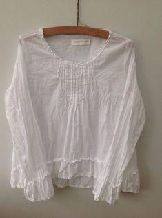 White cotton voile blouse.