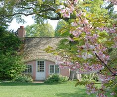 pink cottage - it looks like the rabbit family out to walk out the front door