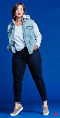 We're obsessed with Ashley Graham's street style-inspired look from head to toe. A pair of dark skinny jeans from Levi's creates the perfect base for a white tee, a hooded trucker jacket and slip-on sneakers. Create your perfect weekend look with denim styles from Macy's.