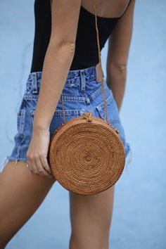 """**PRE-ORDER DELIVERY FROM APRIL 10TH**  Inspired by a 1970s vintage bag we found in the depths of Paris our 70s  Roundie Bag is a treasure in itself.  Hand woven from Tenganan Village in Bali each basket is hand woven and  """"smoked"""" over coconut husks, add"""