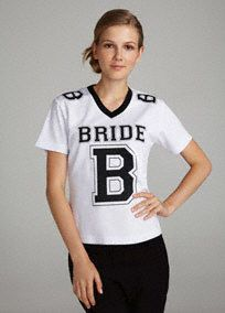 #DBBridalStyle Tackle, Kick and Block your way to a good time in this fun Bride Football Jersey! Celebrate your wedding with this playful and festive Bridal football jersey.  Features and Facts:  Jerseyis available in White with Black lettering.  Available in sizes S-XL.  Imported.  Please note this style is available in limited stores. Please call your local store to check availability.