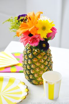 Use a pineapple as a flower vase centerpiece! Party Like a Pineapple birthday party via Kara Allen | Kara's Party Ideas | KarasPartyIdeas.com Pineapple party ideas, supplies, recipes, decor and more!