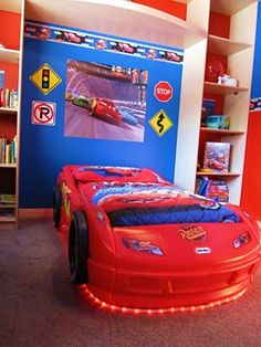 Miniature Traffic Signs AMAZING, Shelves are awesome, don't like the Cars movie theme but his bed is like that but Blue so that works too.