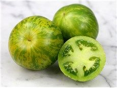 Green Zebra: Beautiful chartreuse with deep lime-green stripes, very attractive. Flesh is bright green and very rich tasting, sweet with a sharp bite to it (just too good to describe!). A favorite tomato of many high class chefs, specialty markets, and home gardeners. Yield is excellent. 10 cm diameter.