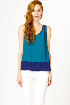 Teal and blue color blocked sleeveless by Skies are Blue.