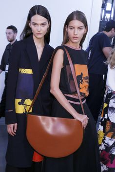 """Victoria Beckham Half Moon Bag //  After seasons of sizing down, designers are amping up proportions again— as in this half-moon bag from Victoria Beckham that screams """"go big or go home."""""""