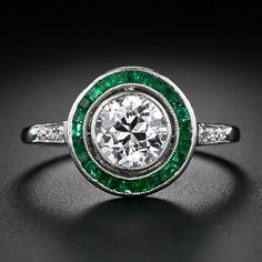 .95 carat Art Deco diamond engagement ring with calibre emeralds.  Via Diamonds in the Library. @designerwallace