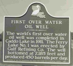 this is in my back yard!   Oil Drilling on Caddo Lake
