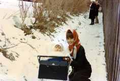 Audrey Hepburn photographed with her youngest son Luca Dotti in Gstaad in December 1970. Audrey was wearing a Valentino coat and a Patrick de Barentzen scarf.