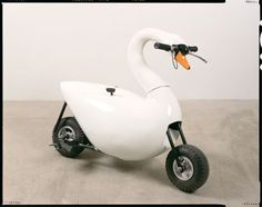 Swan bike.  I want to ride into Sturgis on this, so much cooler than any Harley!    kc