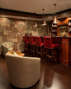 cool basement-love the bar and the lighting and the comfy chairs-not sure on the red chairs might change out those